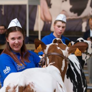 4-H Canada Youth Advisory Committee member Erica Jackson shows off her prize cow at a competition in Belgium